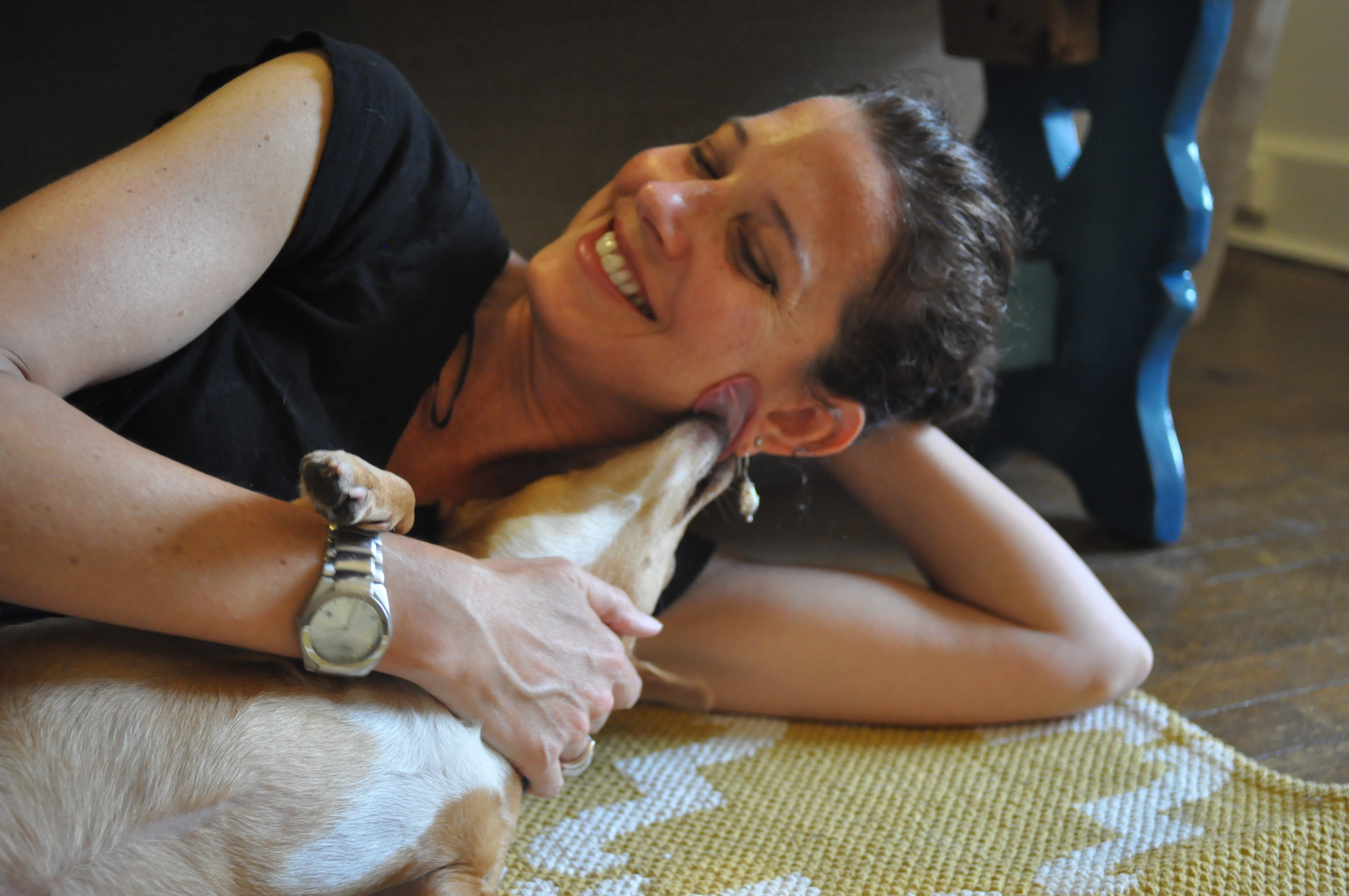 Elena, the adorable dog who was reacued by CAP, hangs out at her new home with PETA staffer Rachel Bellis.
